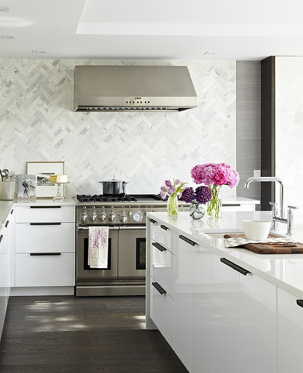 White kitchen with purple flower arrangements