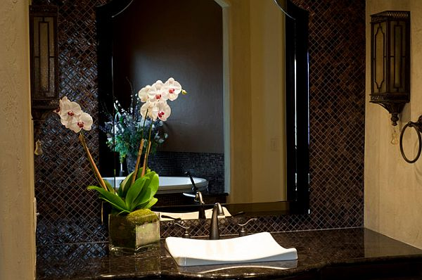 white orchids for a dark bathroom