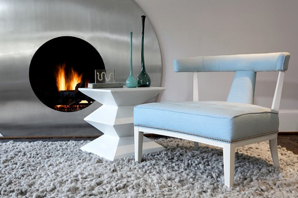 A pastel chair in a silver gray living room