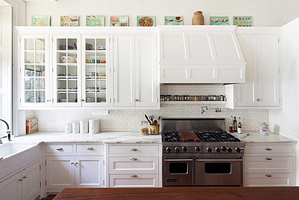 Artwork atop cabinets in a bright kitchen