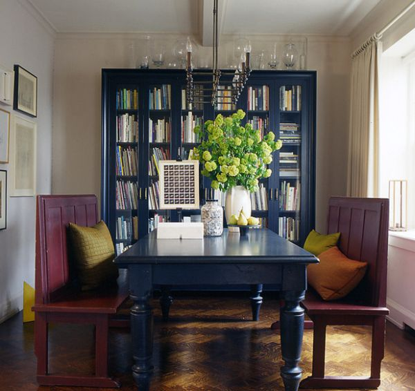 Beautiful bookcase in navy blue make for a lovely backdrop for Navy dining room ideas