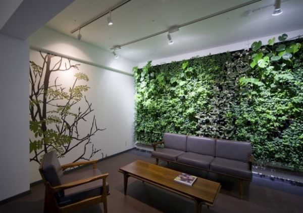 Beautiful green wall along with wall art for the lounge