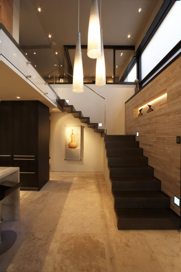 Beautiful pendant lights and staircase leading to the second level