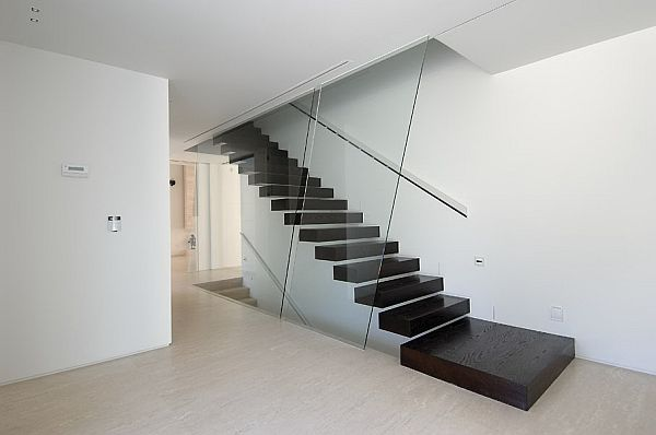 Black floating staircase design against a white backdrop