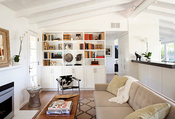 Books and art pieces in an eclectic living room