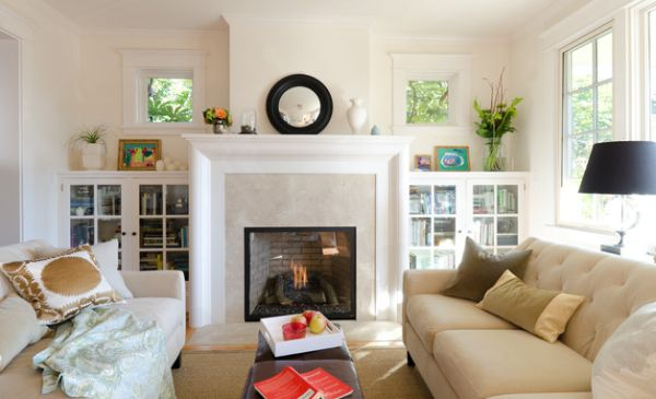 Bookshelves with glass doors flanking the fireplace in the living room