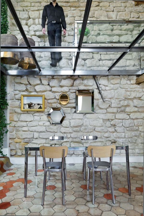 Compact dining area also sports plenty of mirrored surfaces