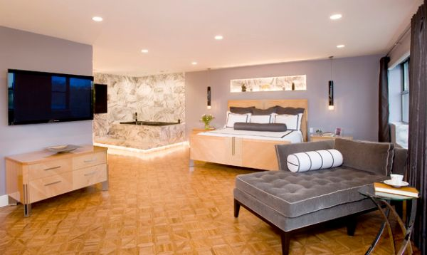 Condo Bedroom With A Chaise Lounge That Offers Visual Contrast