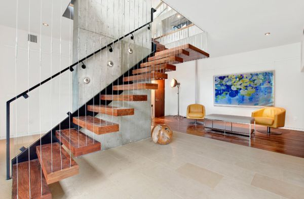Contemporary staircase design idea for those who love the levitating look