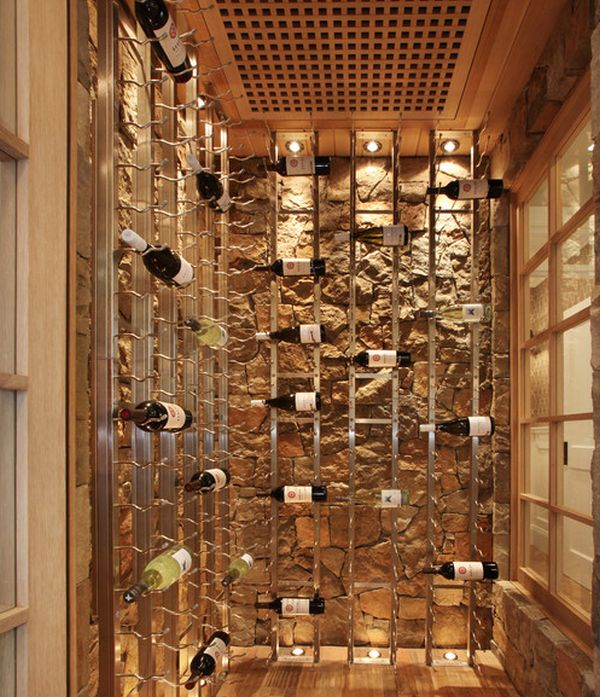 cool wine racks set against a stone backdrop give this cellar an