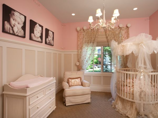 cute nursery in pink with baby pictures on the wall adding a personal