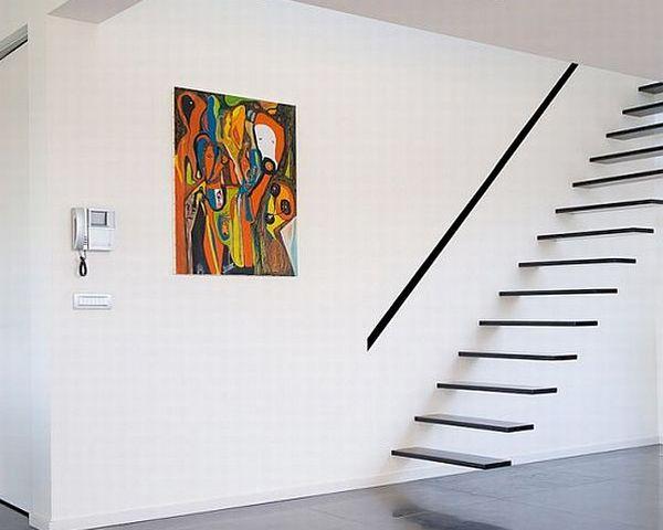 Exquisite floating stairway in black a minimalist's dream!