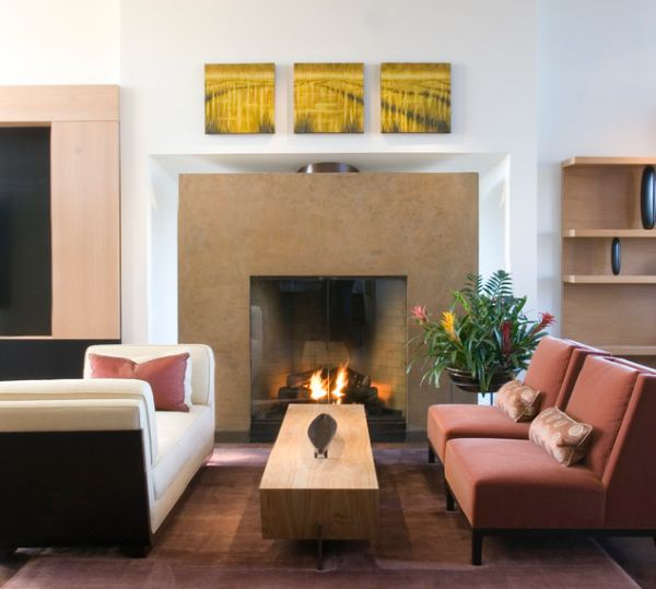 Family room sports a gorgeous fireplace with glass doors