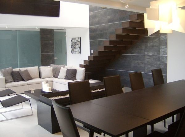 Floating stairways in dark hues blend in with the decor of the home