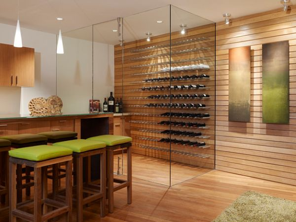 Floor-to-ceiling glass walls employed in this cool contemporary wine cellar