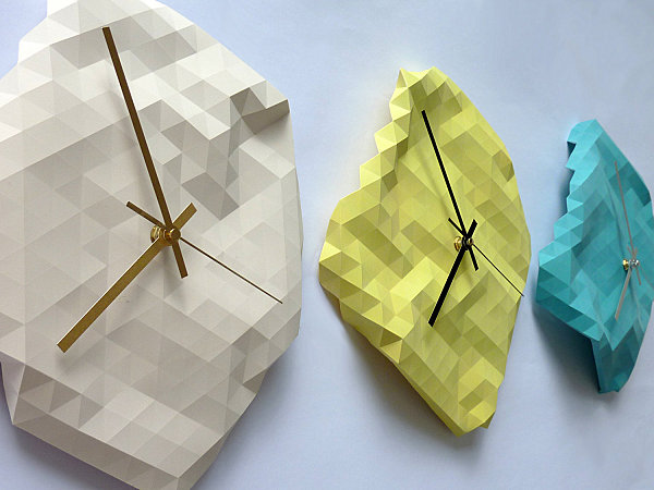 Geometric faceted wall clocks
