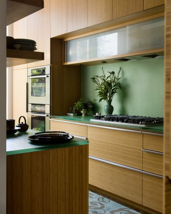 Glass cabinets set in a largely bamboo dominated kitchen!