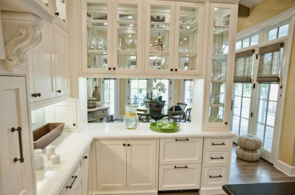 Glass Front Kitchen Cabinets Set In A Wooden Frame