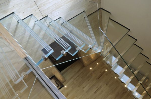 Glass stairs and railing disappear into the backdrop