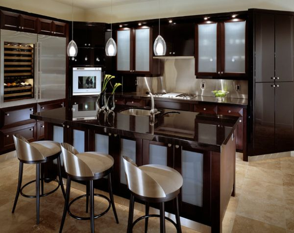 View in gallery Gorgeous contemporary kitchen in dark hues brings in light, airy appeal with frosted glass door
