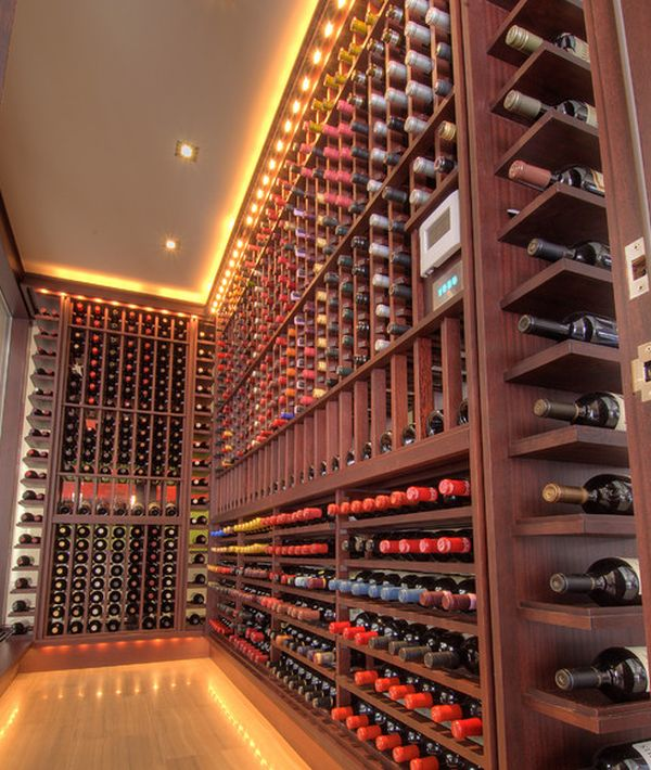 Gorgeous track lighting illuminates this wine cellar