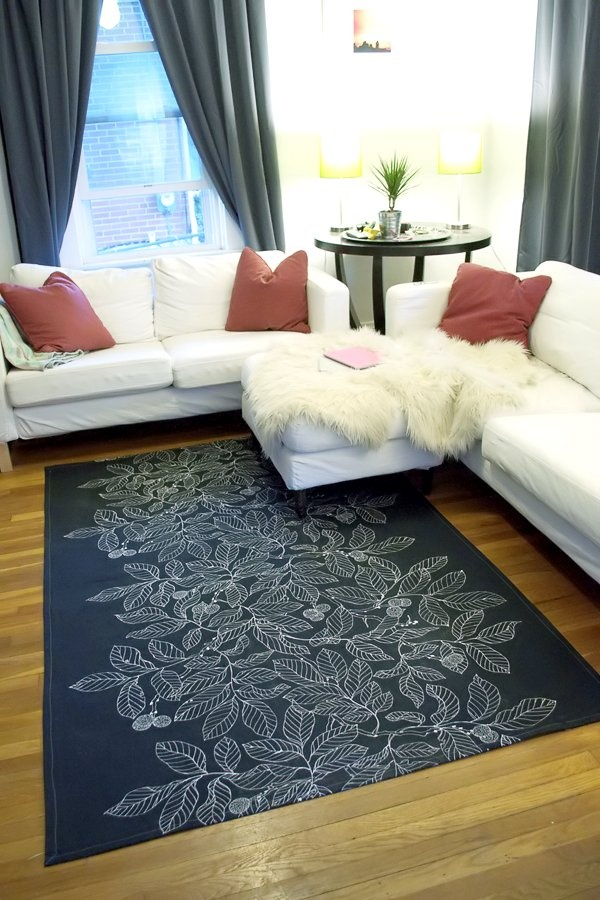 Gray and white stenciled leaf rug