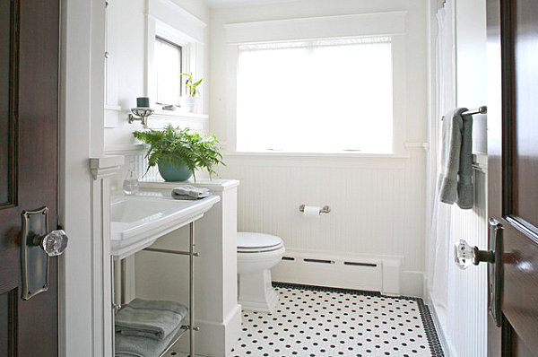 Green fern in a crisp white bathroom