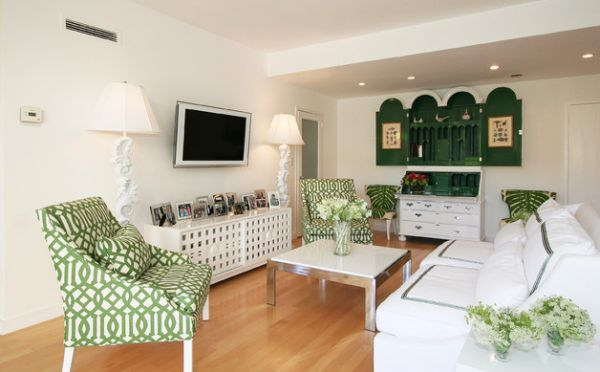 Imperial Trellis by Kelly Wearstler on the chairs blends with the surrounding green shades