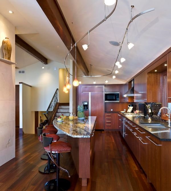 Innovative track lighting installation above the kitchen island