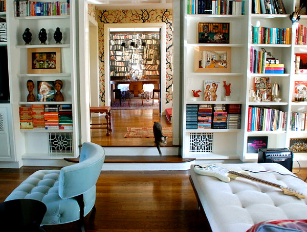 Interesting decorative details on white bookshelves