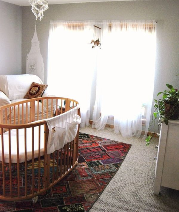 Interesting nursery with a round bed in the center and world monuments as wall art