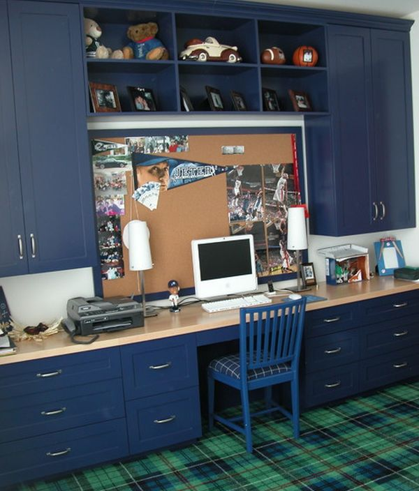 Kids' study in dark blue with ample storage space