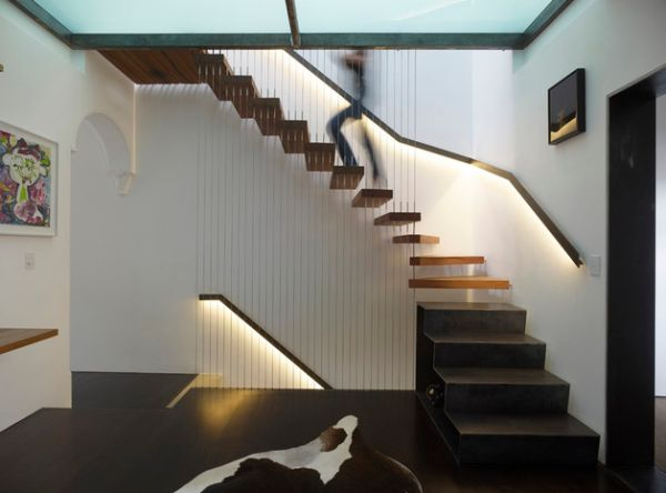 LED-lit railing illuminates this floating stairway gorgeously