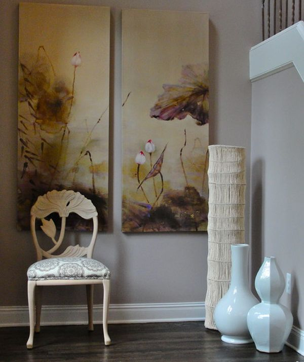 Large white floor vases combine with existing decor and wall art to create an Asian-themed setting