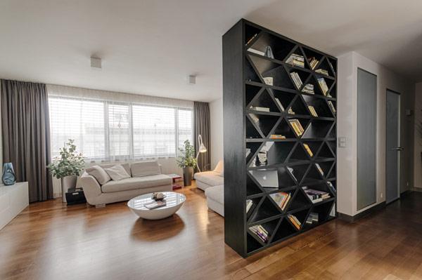 Large windows in the living room provide plenty of natural light