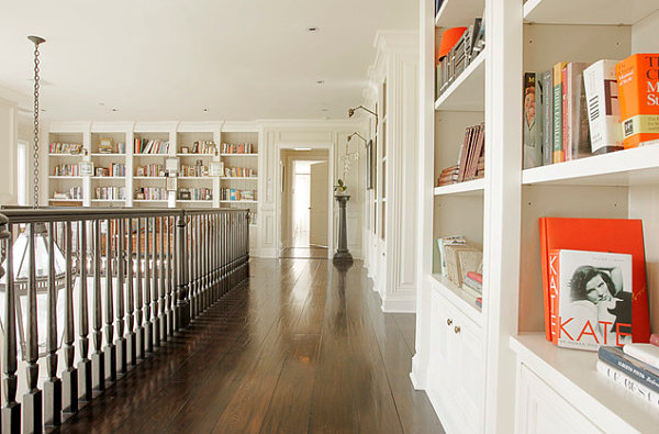 Leaning and stacked books on white shelving