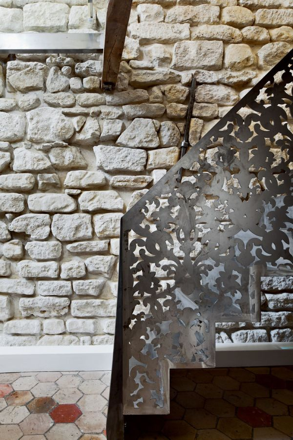 Limestone walls are well preserved to showcase the history of the space