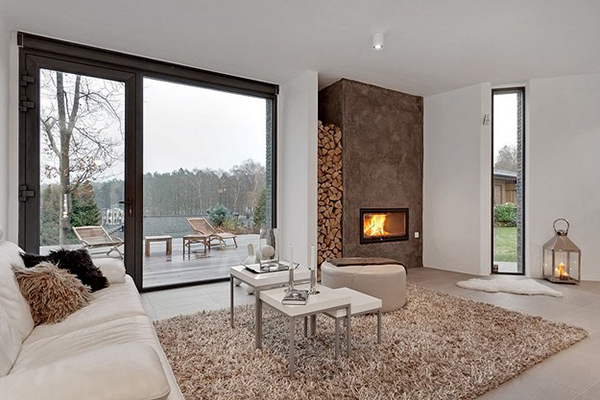 Living room with fireplace Luxurious Modern Swedish Villa Charms With A Blend Of Elegance And Ergonomics