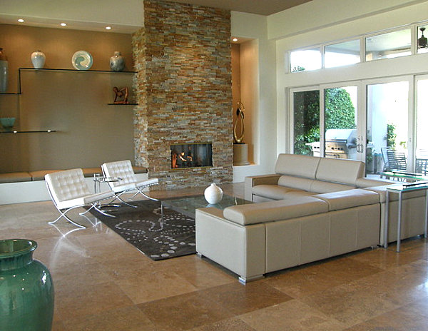 Lounge area sporting a beautiful stone fireplace