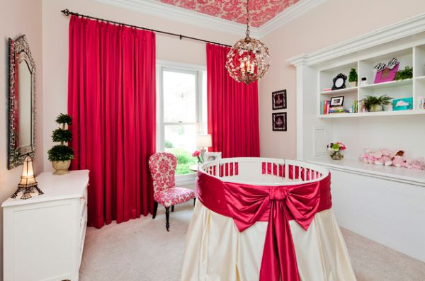 Lovely accents of red and white style up this cute round crib