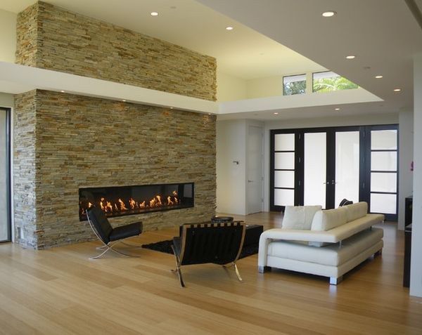 Lovely linear fireplace set in a stone wall