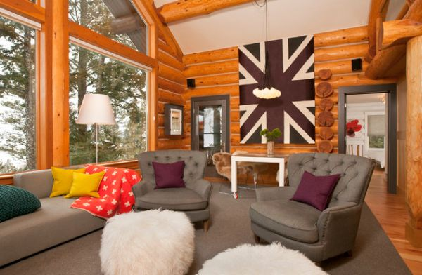 Lovely wall art adds the Union Jack to this modern log cabin in cool colors