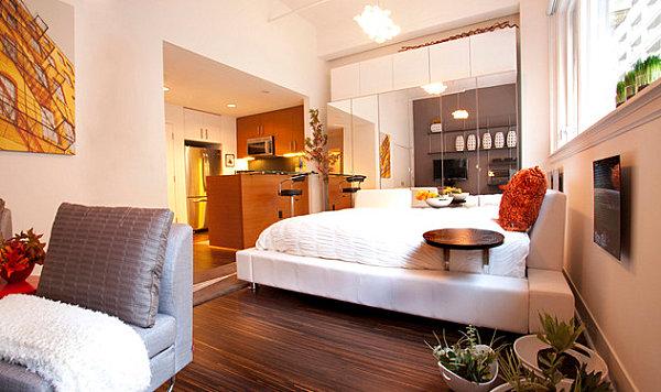 Mirrored closet doors in a compact bedroom
