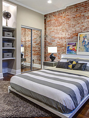 Mirrored closets in a modern industrial bedroom