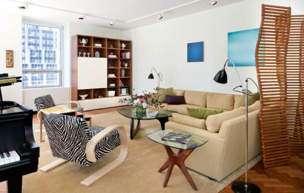 view in gallery modern condo in white employs track lighting to bring in a light and airy appeal - Track Lighting Ideas For Living Room