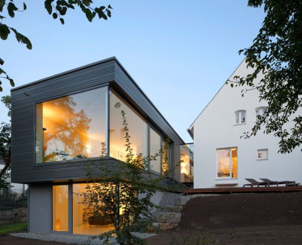 Modern extension to a traditional home Traditional German Home Acquires A Sparkling Modern Extension