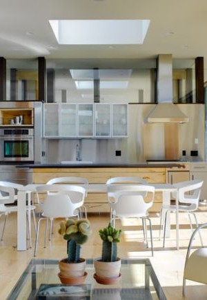 Modern kitchen with glass cabinets that fit in perfectly with the existing theme