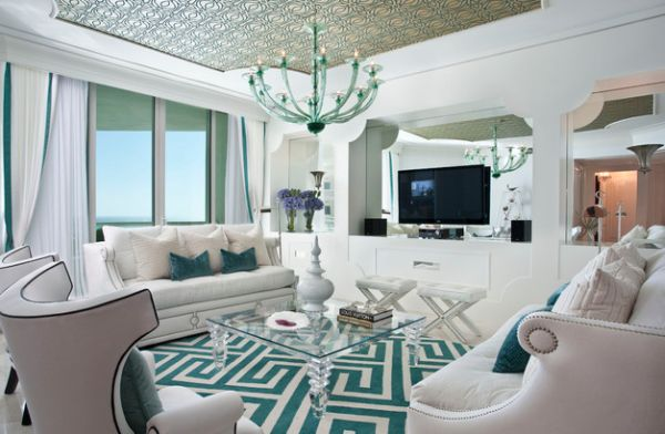 living room in white and tiffany blue clad in hollywood regency style
