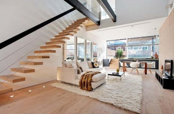 Modern living room with stylish floating staircase