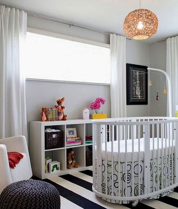 Modern nursery with a col circular crib in white